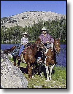 Father and son horsback riding in Jackson Hole