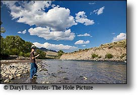 Boy fishing South fork shoshone river, cody wyoming