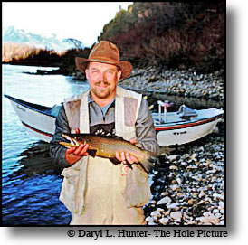 fisherman with brown trout Yellowstone River