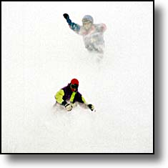 skiers enjoying deep powder
