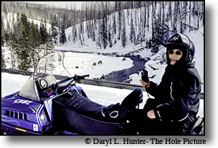seventy year old Louise Mcdonald snowmobiling in Yellowstone
